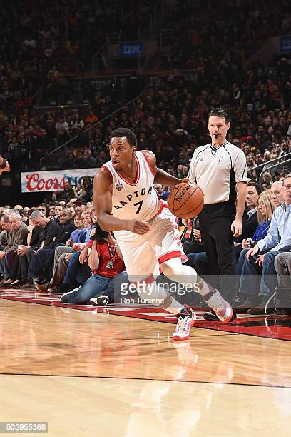 Kyle Lowry of the Toronto Raptors drives to the basket during the game against the Washington Wizards on December 28 2015 at the Air Canada Centre in...