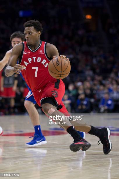 Kyle Lowry of the Toronto Raptors drives to the basket in the fourth quarter against the Philadelphia 76ers at the Wells Fargo Center on January 15...