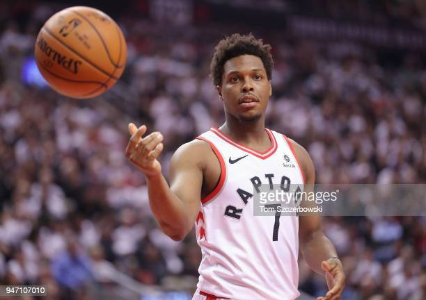 Kyle Lowry of the Toronto Raptors flips the ball to the official against the Washington Wizards in the first quarter during Game One of the first...