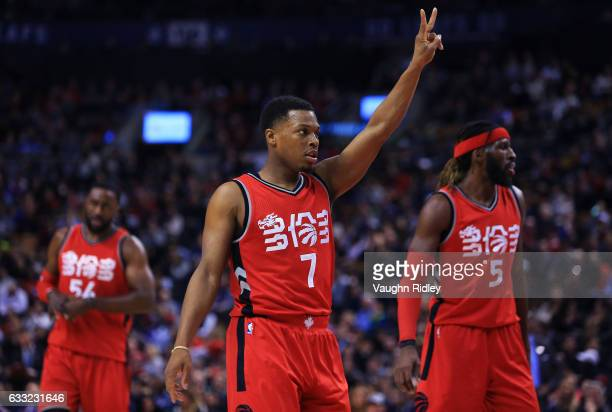 Kyle Lowry of the Toronto Raptors gestures to teammates during the second half of an NBA game against the New Orleans Pelicans at Air Canada Centre...