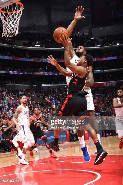 Kyle Lowry of the Toronto Raptors goes to the basket against the LA Clippers on December 11 2017 at STAPLES Center in Los Angeles California NOTE TO...