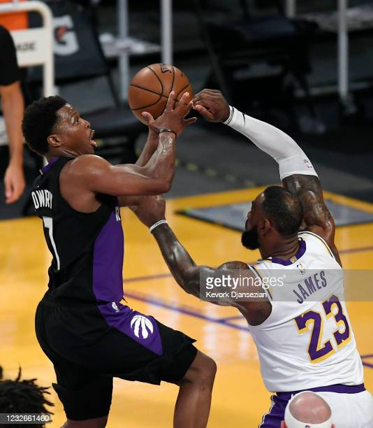 Kyle Lowry of the Toronto Raptors goes up for a basket against LeBron James of the Los Angeles Lakers during the first half at Staples Center on May...