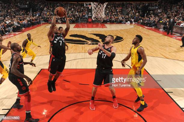 Kyle Lowry of the Toronto Raptors grabs a rebound against the Indiana Pacers on December 1 2017 at the Air Canada Centre in Toronto Ontario Canada...