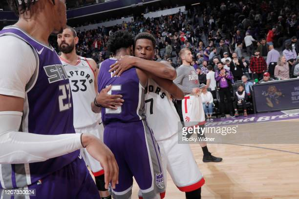 Kyle Lowry of the Toronto Raptors greets De'Aaron Fox of the Sacramento Kings on March 8 2020 at Golden 1 Center in Sacramento California NOTE TO...
