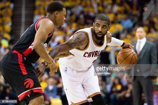 Kyle Lowry of the Toronto Raptors guards Kyrie Irving of the Cleveland Cavaliers during the second half of Game One of the NBA Eastern Conference...