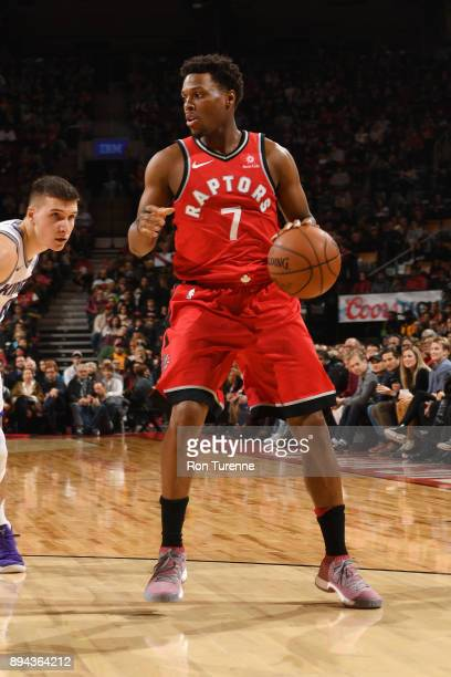 Kyle Lowry of the Toronto Raptors handles the ball against the Sacramento Kings on December 17 2017 at the Air Canada Centre in Toronto Ontario...