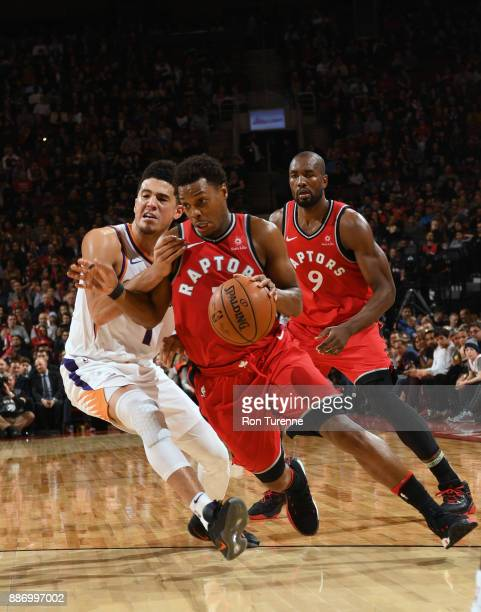 Kyle Lowry of the Toronto Raptors handles the ball against the Phoenix Suns on December 5 2017 at the Air Canada Centre in Toronto Ontario Canada...