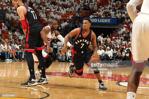 Kyle Lowry of the Toronto Raptors handles the ball during the game against the Miami Heat in Game Three of the Eastern Conference Semifinals during...
