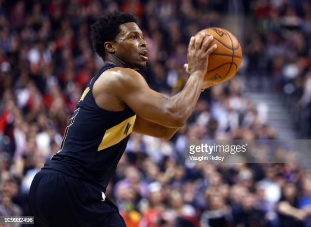 Kyle Lowry of the Toronto Raptors handles the ball during the second half of an NBA game against the Houston Rockets at Air Canada Centre on March 9...