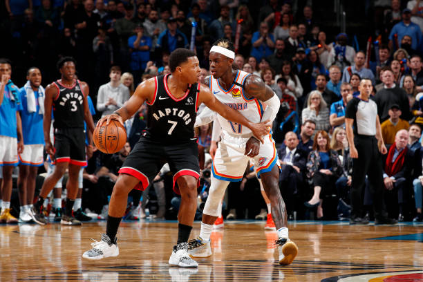 Kyle Lowry of the Toronto Raptors handles the ball while Dennis Schroder of the Oklahoma City Thunder plays defense during the game on January 15,...