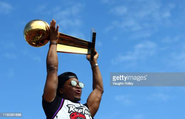Kyle Lowry of the Toronto Raptors holds the championship trophy during the Toronto Raptors Victory Parade on June 17 2019 in Toronto Canada The...