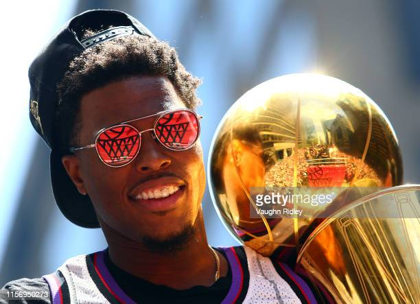 Kyle Lowry of the Toronto Raptors holds the championship trophy during the Toronto Raptors Victory Parade on June 17, 2019 in Toronto, Canada. The...