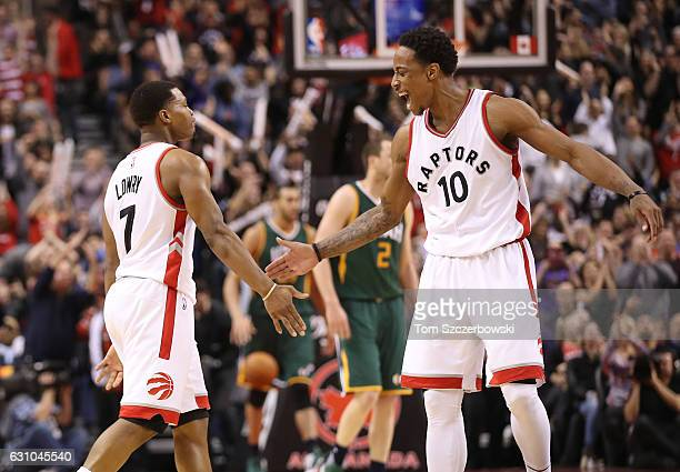 Kyle Lowry of the Toronto Raptors is congratulated by DeMar DeRozan after scoring a threepointer against the Utah Jazz during NBA game action at Air...