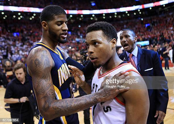 Kyle Lowry of the Toronto Raptors is congratulated by Paul George of the Indiana Pacers following the final whistle of Game Seven of the Eastern...