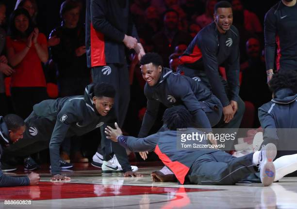 Kyle Lowry of the Toronto Raptors is greeted by his teammates as he is introduced before the start of their NBA game against the Charlotte Hornets at...