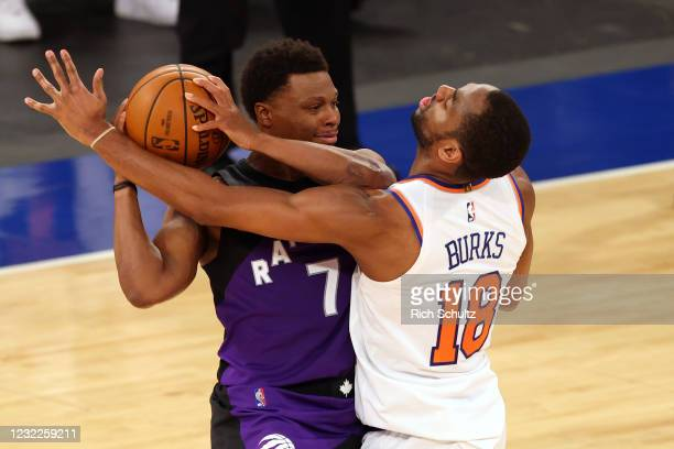Kyle Lowry of the Toronto Raptors is guarded by Alec Burks of the New York Knicks at Madison Square Garden on April 11, 2021 in New York City. The...