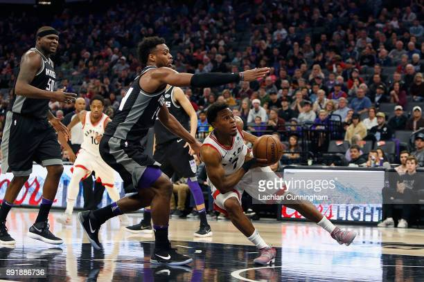 Kyle Lowry of the Toronto Raptors is guarded by Buddy Hield of the Sacramento Kings at Golden 1 Center on December 10 2017 in Sacramento California...