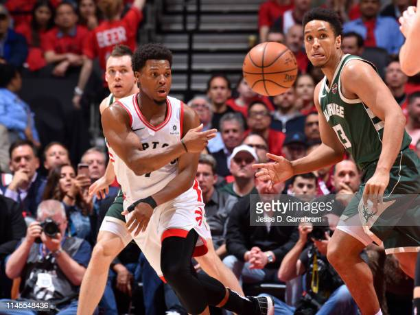 Kyle Lowry of the Toronto Raptors passes the ball against the Milwaukee Bucks during Game Four of the Eastern Conference Finals of the 2019 NBA...