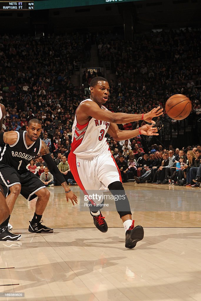 Kyle Lowry #3 of the Toronto Raptors passes the ball against the Brooklyn Nets during the game on April 14, 2013 at the Air Canada Centre in Toronto, Ontario, Canada.