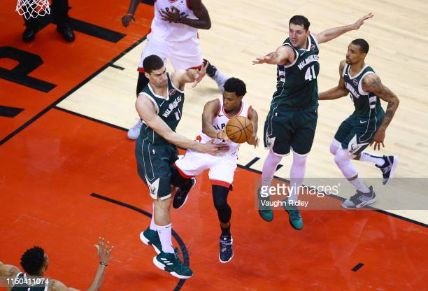 Kyle Lowry of the Toronto Raptors passes the ball during the second half against the Milwaukee Bucks in game three of the NBA Eastern Conference...