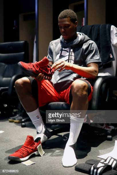 Kyle Lowry of the Toronto Raptors puts on his sneakers before the game against the Milwaukee Bucks during Game Five of the Eastern Conference...