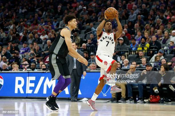 Kyle Lowry of the Toronto Raptors puts up a shot against Justin Jackson of the Sacramento Kings at Golden 1 Center on December 10 2017 in Sacramento...