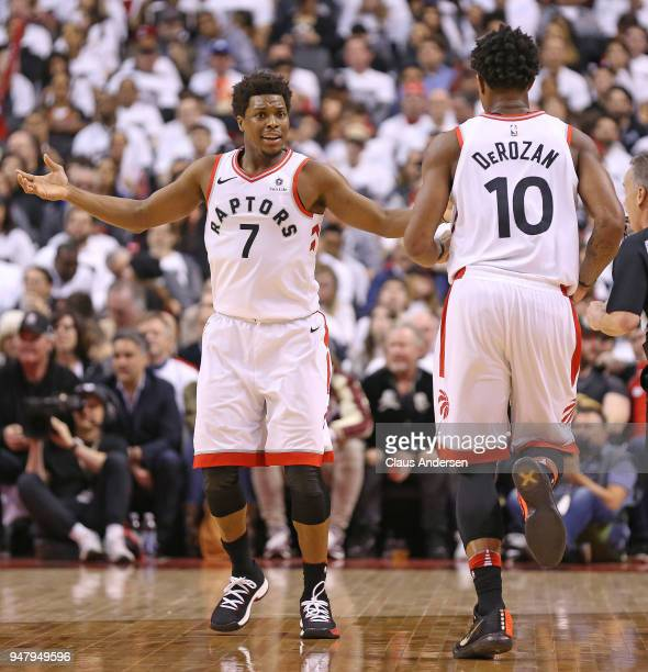 Kyle Lowry of the Toronto Raptors questions a call to teammate DeMar DeRozan against the Washington Wizards in Game Two of the Eastern Conference...