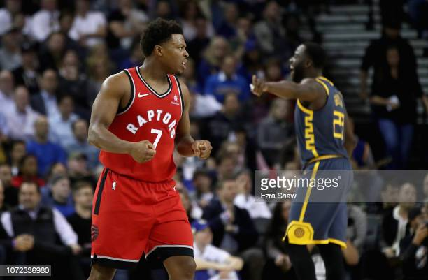Kyle Lowry of the Toronto Raptors reacts after Greg Monroe made a basket against the Golden State Warriors at ORACLE Arena on December 12 2018 in...