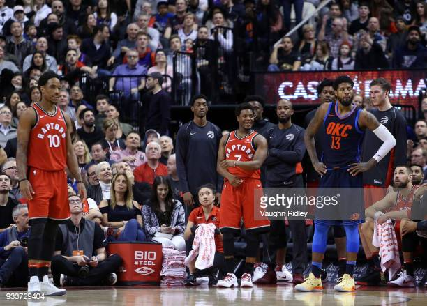 Kyle Lowry of the Toronto Raptors reacts after seeing a replay of his 6th foul of the game during the second half of an NBA game against the Oklahoma...