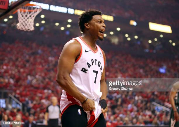 Kyle Lowry of the Toronto Raptors reacts to a call during the first half against the Milwaukee Bucks in game three of the NBA Eastern Conference...