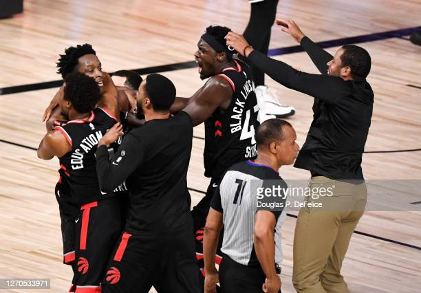 Kyle Lowry of the Toronto Raptors reacts with teammates after their win over Boston Celtics in Game Three of the Eastern Conference Second Round...