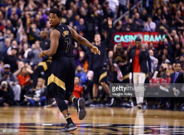 Kyle Lowry of the Toronto Raptors runs down court during the second half of an NBA game against the Houston Rockets at Air Canada Centre on March 9...