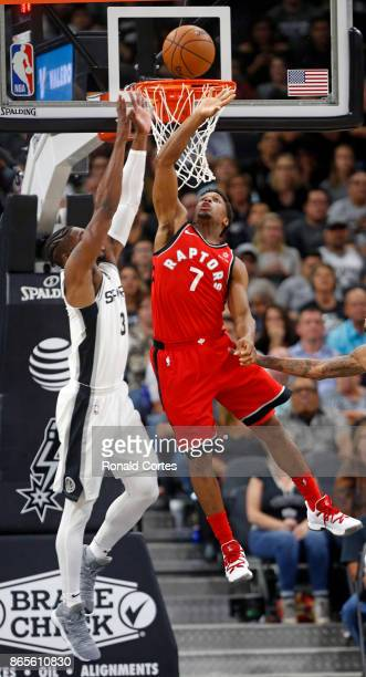 Kyle Lowry of the Toronto Raptors scores two on pass as Brandon Paul of the San Antonio Spurs tries to defend at ATT Center on October 23 2017 in San...
