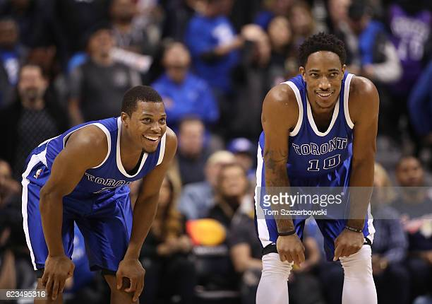 Kyle Lowry of the Toronto Raptors shares a laugh with DeMar DeRozan during NBA game action against the New York Knicks at Air Canada Centre on...