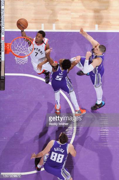 Kyle Lowry of the Toronto Raptors shoots a layup against De'Aaron Fox of the Sacramento Kings on March 8 2020 at Golden 1 Center in Sacramento...