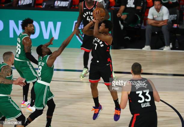 Kyle Lowry of the Toronto Raptors shoots against Kemba Walker of the Boston Celtics in the second half during Game Six of the second round of the...