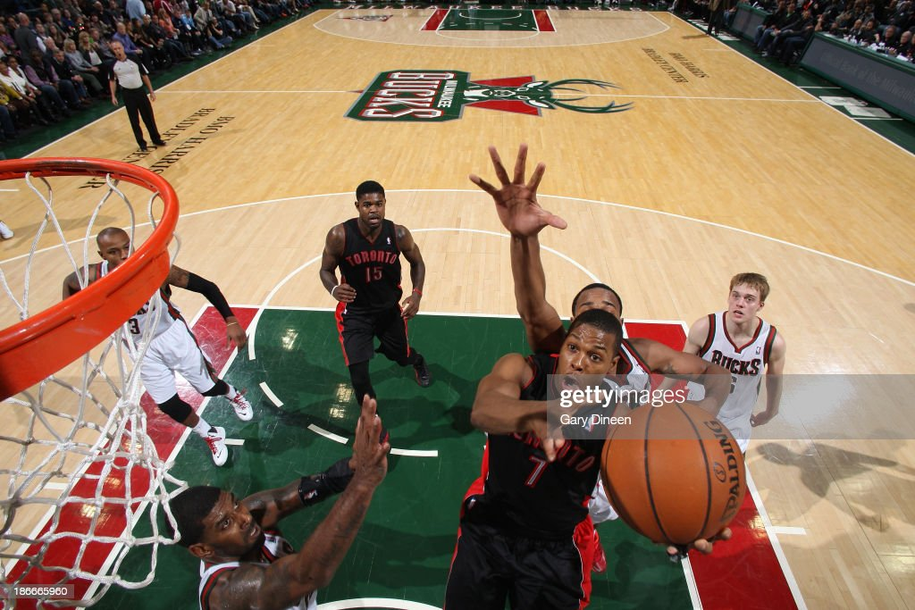 Kyle Lowry #7 of the Toronto Raptors shoots against OJ Mayo #00 of the Milwaukee Bucks on November 2, 2013 at the BMO Harris Bradley Center in Milwaukee, Wisconsin.