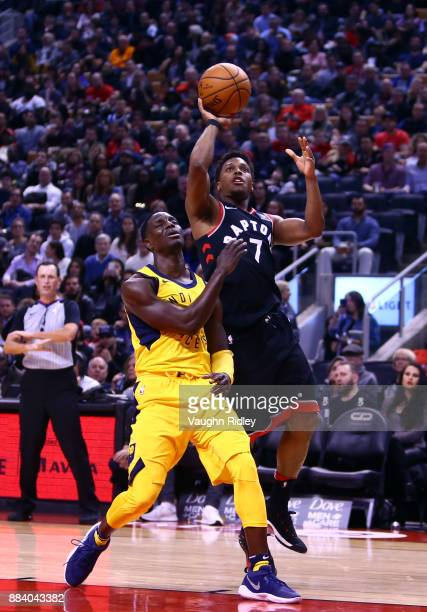 Kyle Lowry of the Toronto Raptors shoots the ball as Darren Collison of the Indiana Pacers defends during the second half of an NBA game at Air...