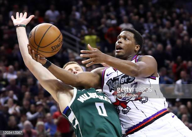 Kyle Lowry of the Toronto Raptors shoots the ball as Donte DiVincenzo of the Milwaukee Bucks defends during the second half of an NBA game at...