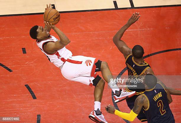 Kyle Lowry of the Toronto Raptors shoots the ball as he falls during the second half against the Cleveland Cavaliers in game three of the Eastern...