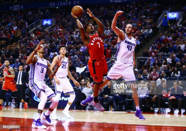 Kyle Lowry of the Toronto Raptors shoots the ball as Kosta Koufas of the Sacramento Kings defends during the second half of an NBA game at Air Canada...