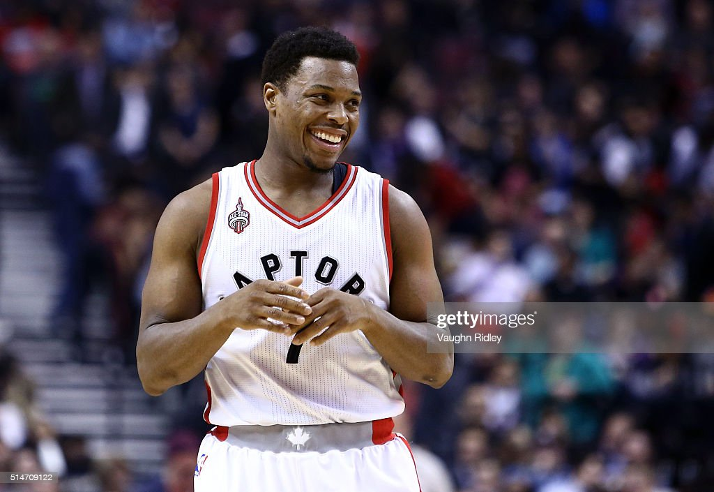 Kyle Lowry #7 of the Toronto Raptors smiles during the first half of an NBA game against the Atlanta Hawks at the Air Canada Centre on March 10, 2016 in Toronto, Ontario, Canada.