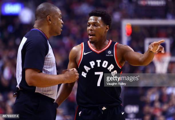 Kyle Lowry of the Toronto Raptors speaks to an official during the first half of an NBA game against the Indiana Pacers at Air Canada Centre on...