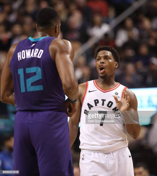 Kyle Lowry of the Toronto Raptors talks to Dwight Howard of the Charlotte Hornets moments before the start of their NBA game at Air Canada Centre on...