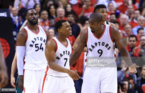 Kyle Lowry of the Toronto Raptors talks with Serge Ibaka in the second half of Game Two of the Eastern Conference Quarterfinals against the Milwaukee...