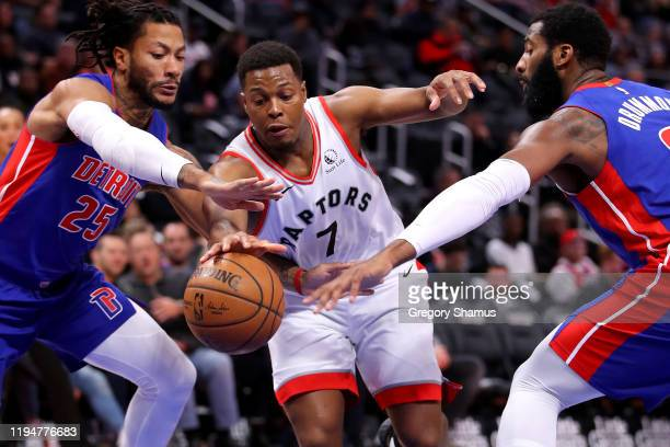 Kyle Lowry of the Toronto Raptors tries to split the defense of Andre Drummond and Derrick Rose of the Detroit Pistons during the first half at...
