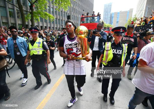 Kyle Lowry of the Toronto Raptors walks down the street with the championship trophy during the Toronto Raptors Victory Parade on June 17, 2019 in...