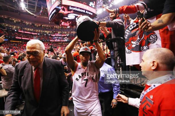 Kyle Lowry of the Toronto Raptors walks off the court with the Eastern Conference Finals trophy after defeating the Milwaukee Bucks 10094 in game six...