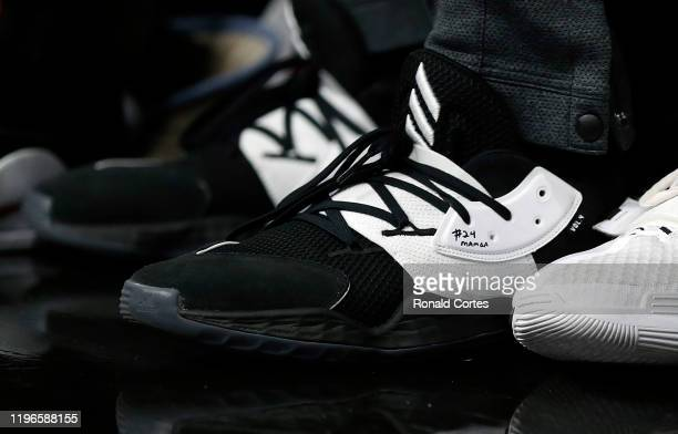 Kyle Lowry of the Toronto Raptors wears shoes with Kobe Bryant's name written on them during the game against the San Antonio Spurs during first half...