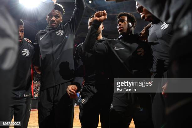 Kyle Lowry of the Toronto Raptors with his teammates huddle before the game against the Brooklyn Nets on December 15 2017 at the Air Canada Centre in...